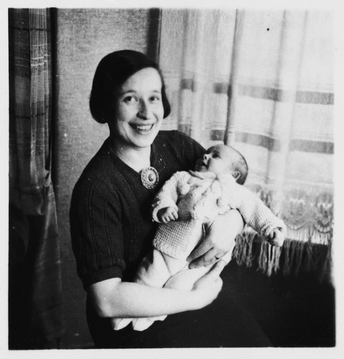 Irmgard Koeppel holds her newborn baby daughter Judith in her arms.