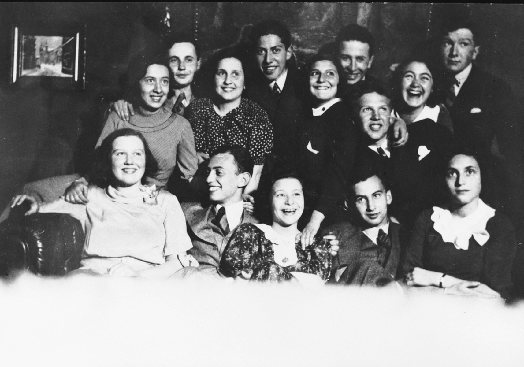 Group portrait of a group of Polish-Jewish students.  Ludmilla Lewinson is pictured third from the left.