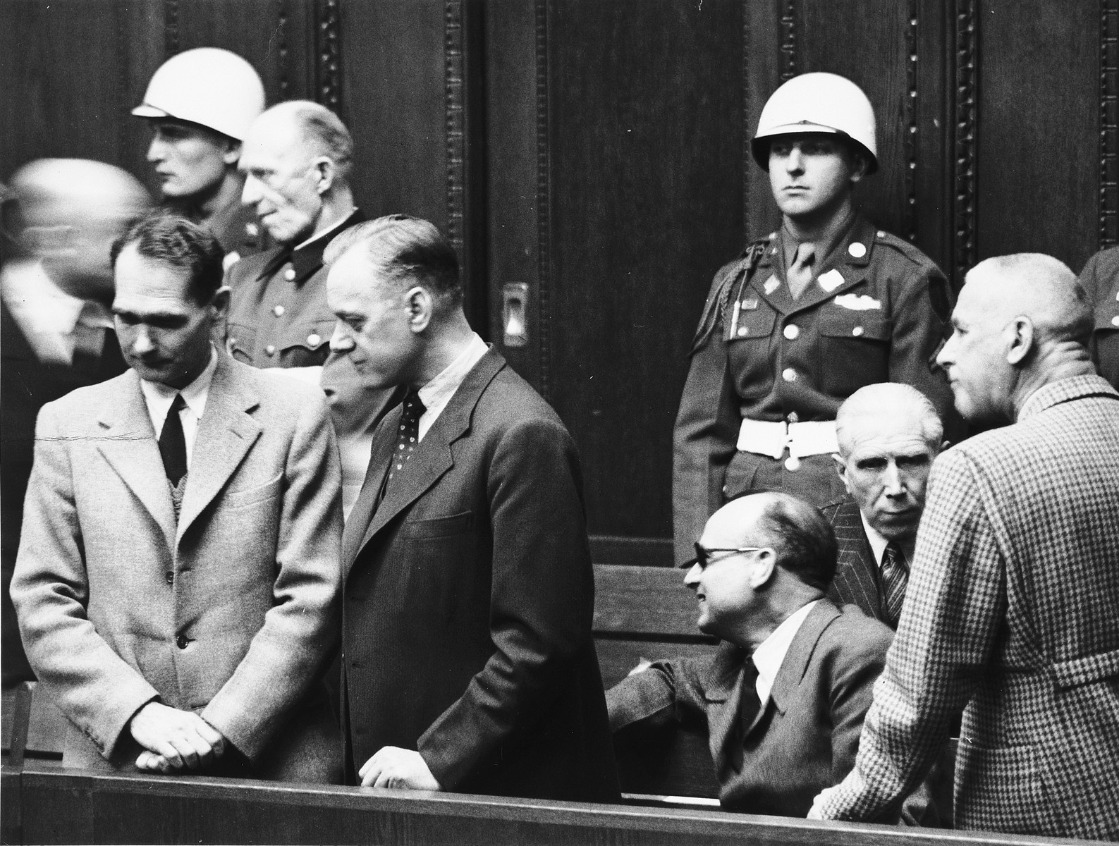 Defendants talk to each other during a break at the International Military Tribunal in Nuremberg.   Pictured from left to right are Rudolf Hess, Alfred Jodl, Alfred Rosenberg, Hans Frank, Franz von Papen and Wilhelm Frick.  Also pictured standing on the right is the donor, the American military policeman, Albert Rose.