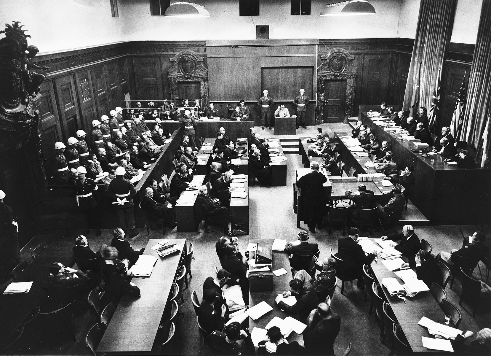 View of the courtroom of the International Military Tribunal in Nuremberg, as seen from the back of the courtroom.  Hermann Goering is at the stand.