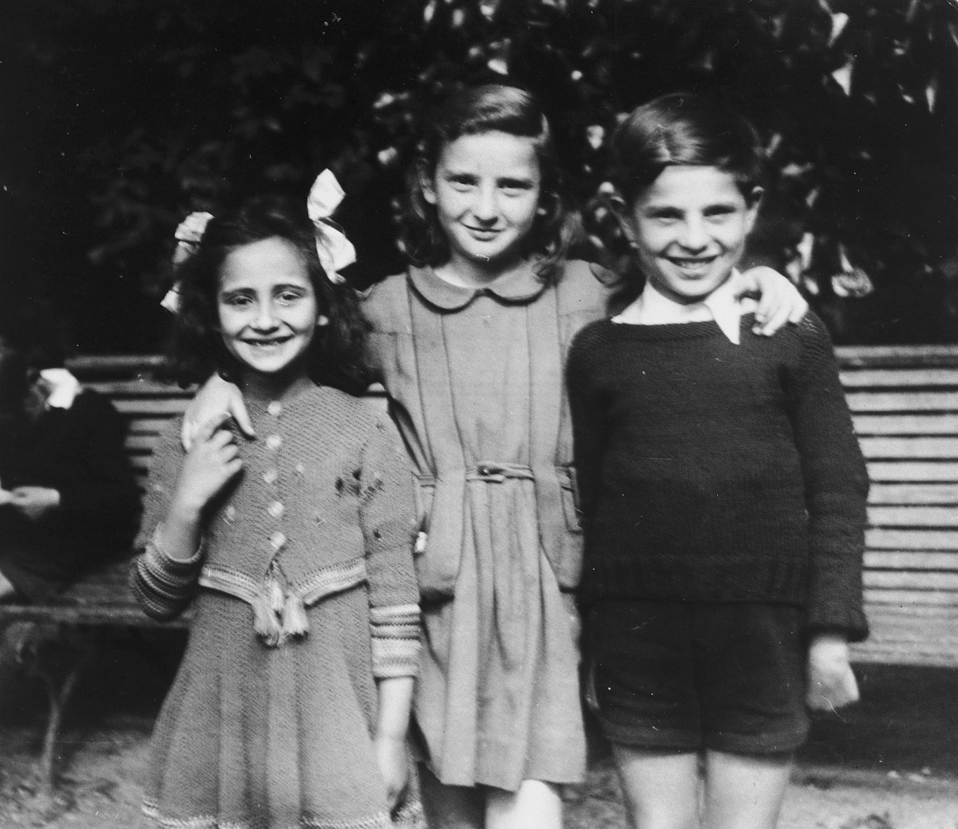 Judith Koeppel poses with her adopted sister (the daughter of her rescuer) and another child after the war.  Judith Koeppel is on the left, and Suzy Enard is in the center.