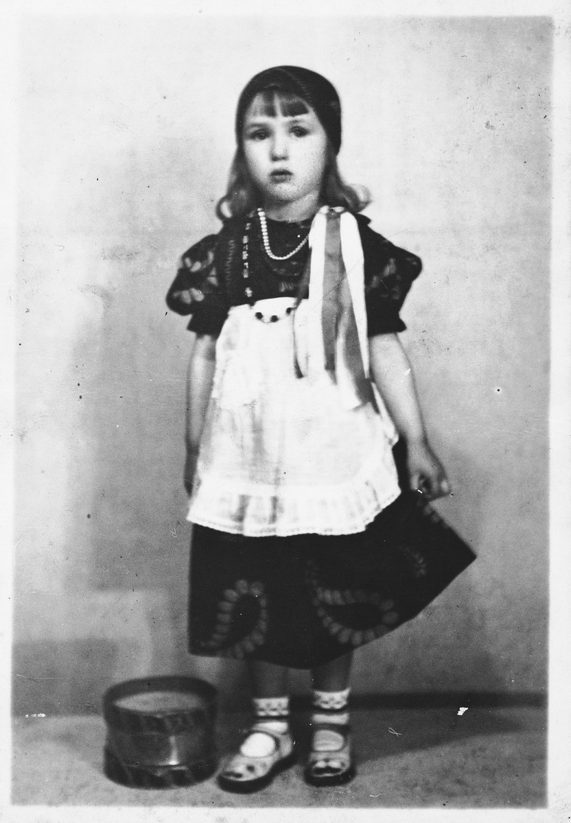 A young Jewish girl poses in a Gypsy costume for Purim in Antwerp, Belgium.  Pictured is Anna Altenberg.