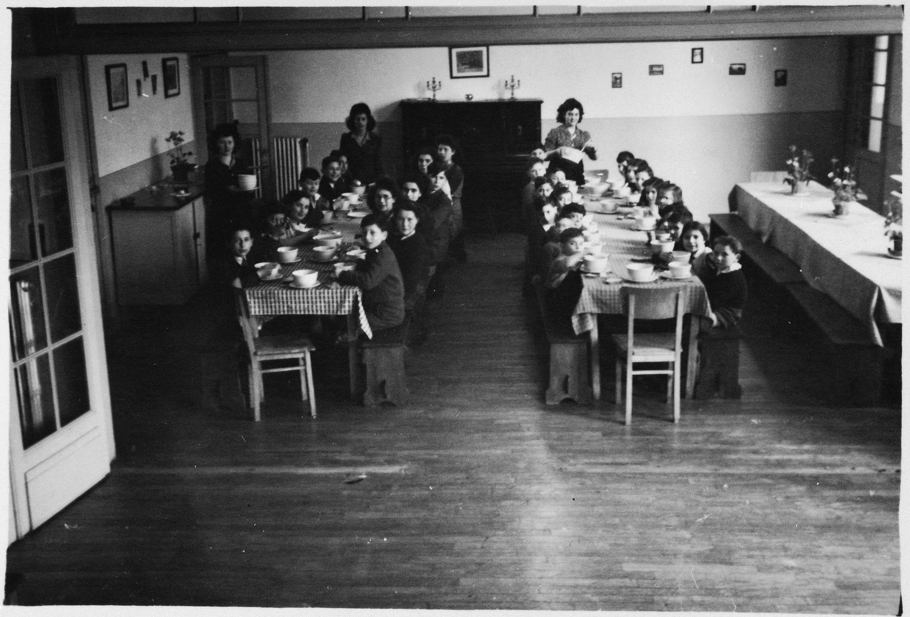 Children gather for a meal in a Jewish children's home in Antwerp.