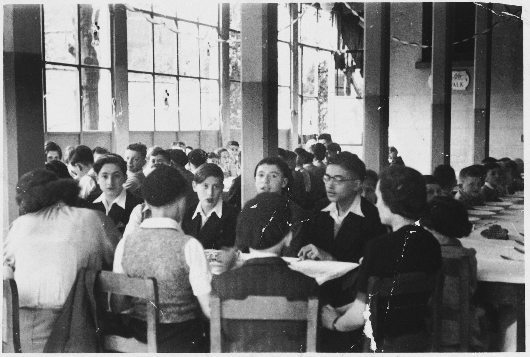 Jewish teenagers celebrate a bar mitzvah in the dining hall of the Wezembeek children's home in Belgium.