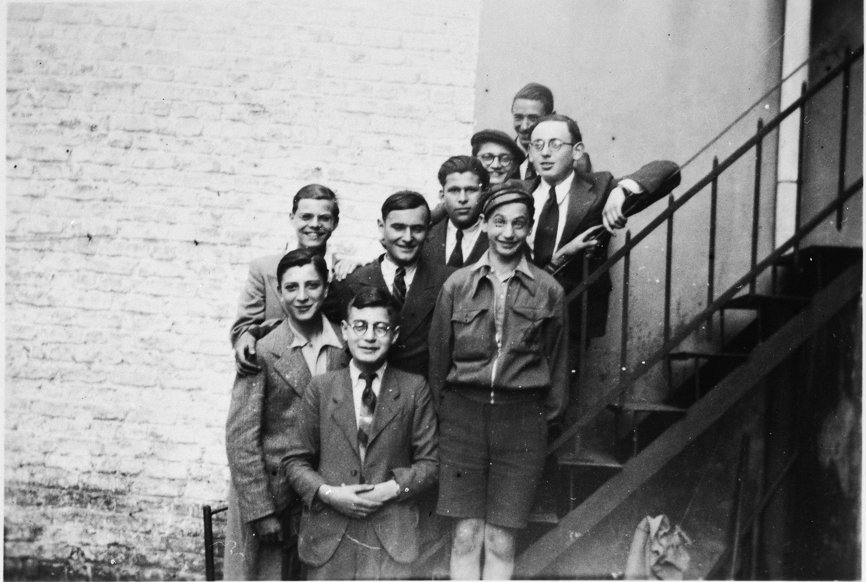 A group of Jewish refugee boys pose outside the Orphelinat Israelite de Bruxelles children's home on the rue des Patriotes.