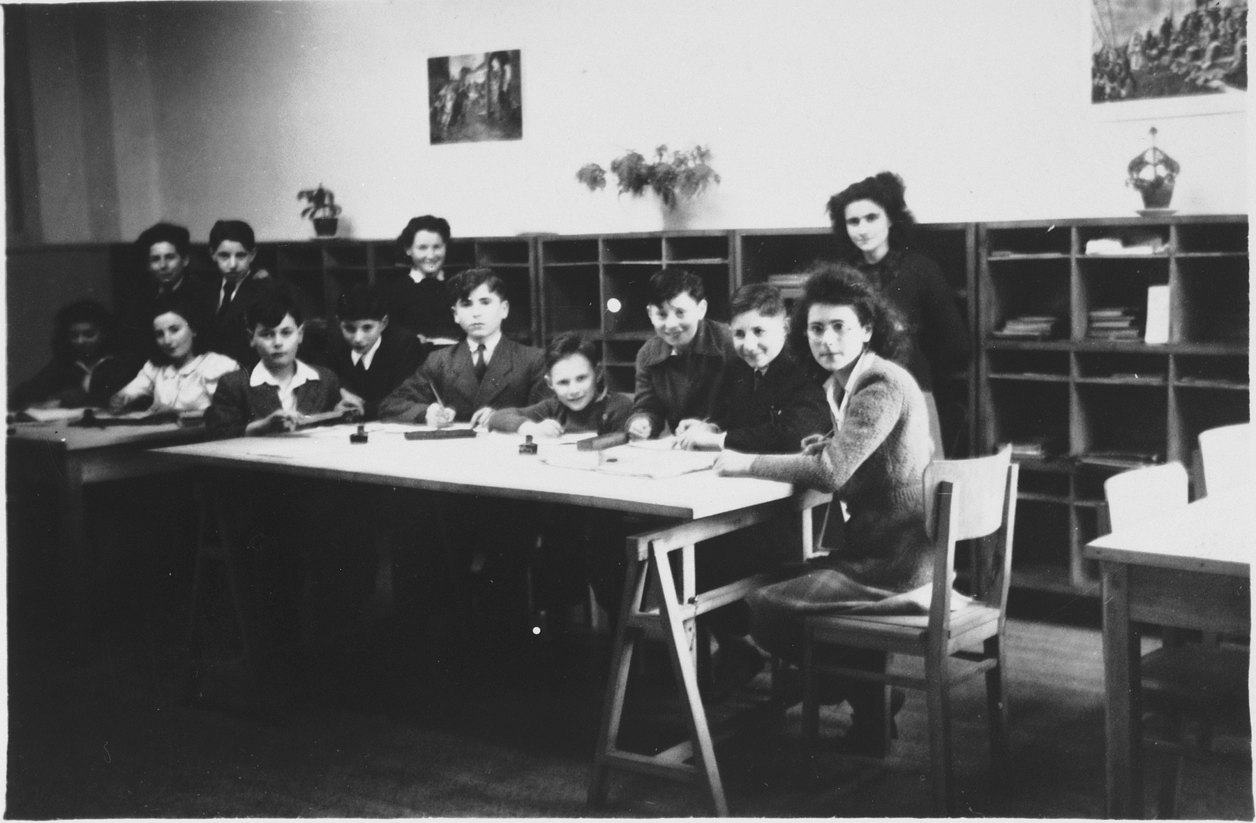 Children write their lessons in the study room of a Jewish children's home in Antwerp.