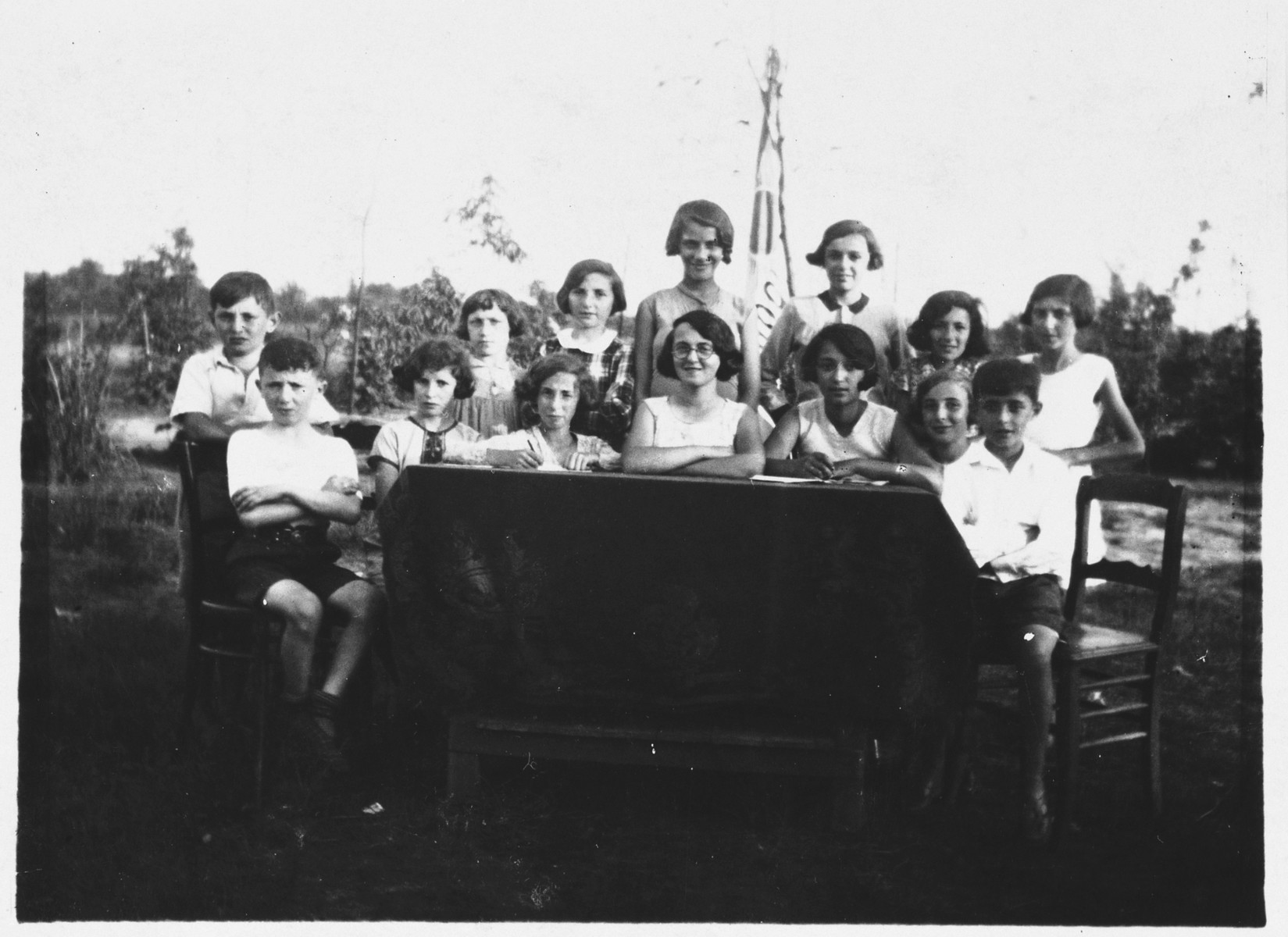 Group portrait of members of the children's committee of the Jewish Zugob school, sponsored by the Jewish Artisan Association.  Among those  pictured (seated center, wearing glasses) are [first name unknown] Erlichman, who was a shoemaker in Antwerp; and (standing far right) Lily Bock.