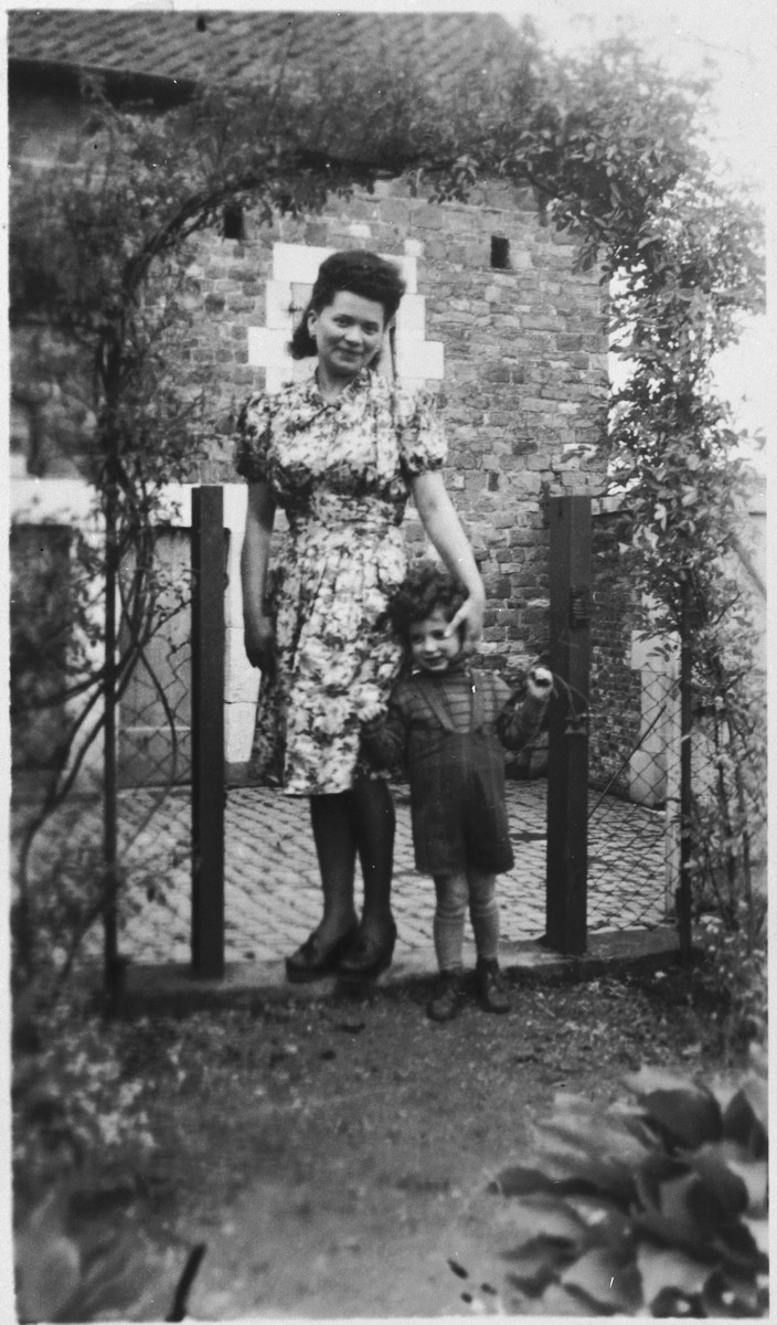 Oscar and Caroline Wasyng pose near the entrance to the garden of the home where they had hidden during the war.