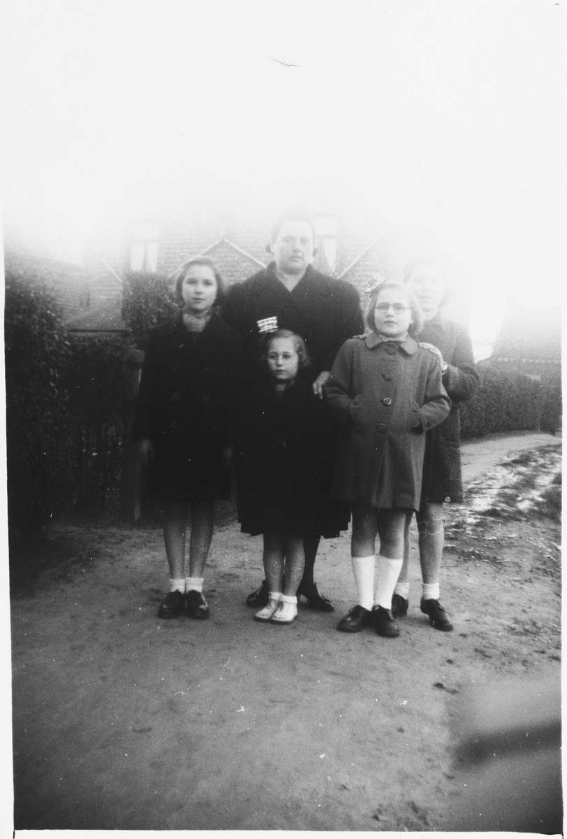 Four Jewish sisters who are living in hiding pose with their rescuer.  Pictured are Anna, Rebecca, Frederica, and Micheline Altenberg.