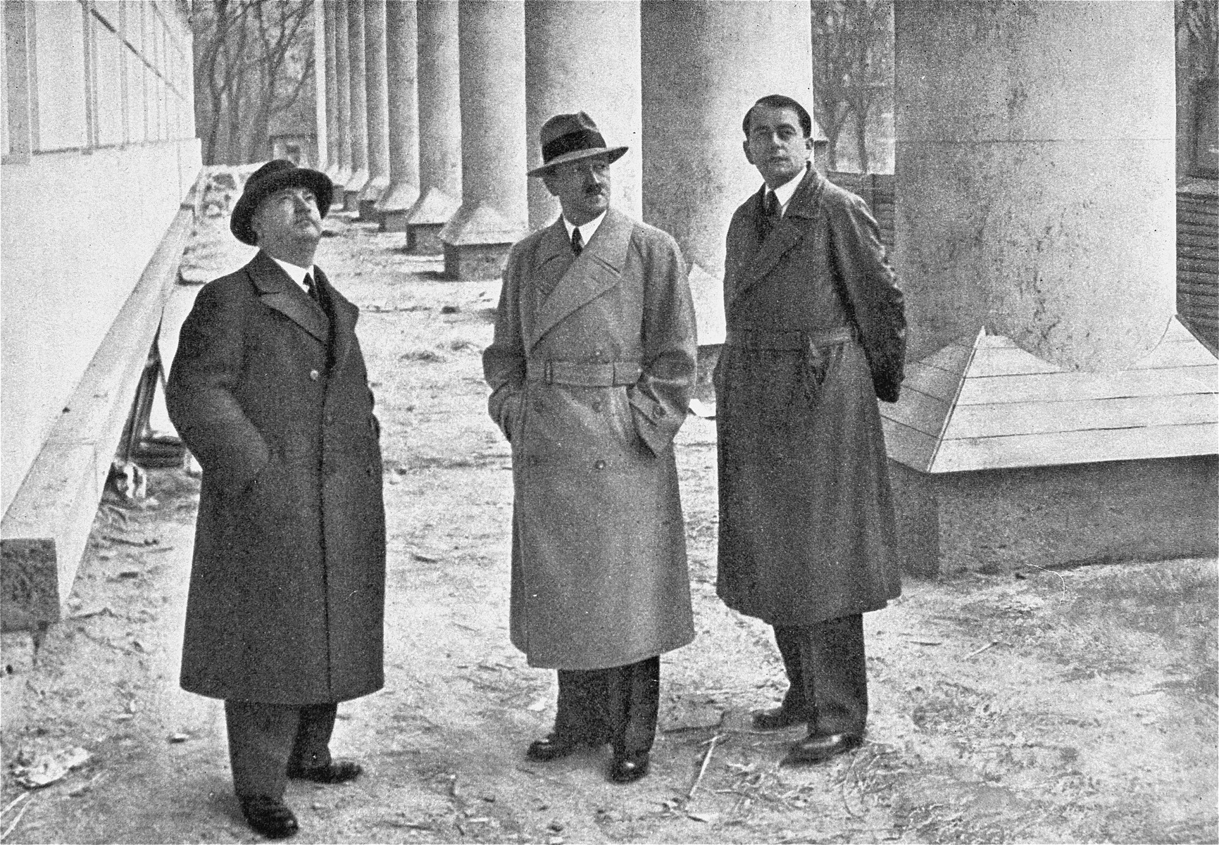Hitler views the progress on the construction of the House of German Art in Munich with the architects Professor Gall (left) and Albert Speer (right).