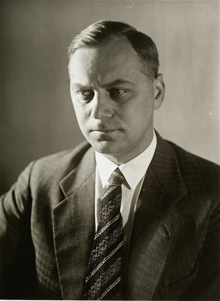 Portrait of Alfred Rosenberg.  Alfred Rosenberg (1893-1946), was a Nazi racial ideologue, German politician, and  Reich Minister for the Occupied Eastern Territories.  A native of Estonia, Rosenberg emigrated to Germany in 1918.  He joined the NSDAP shortly after Adolf Hitler.  Due to his skill in writing propaganda, Rosenberg was made editor of the  Voelkischer Beobachter, the official Nazi party newspaper, in 1921.  During Hitler's imprisonment after the failed Beer-Hall Putsch of 1923, Rosenberg portrayed himself as the ideologue of the outlawed NSDAP.  In 1930 Rosenberg published The Myth of the Twentieth Century, a racial tract positing the existence of two opposing races:  the Aryan race, which is the creator of all values and culture, and a Jewish race, which is the agent of cultural corruption.  Rosenberg was named head of the Nazi party foreign policy office in 1933, but, in fact, he did little more than dabble in diplomatic affairs.  In 1940 Hitler appointed him head of the Hohe Schule, the future University of Nazism.  On its behalf Rosenberg's emmisaries ransacked Jewish libraries throughout Europe, bringing their spoils to Frankfurt.  Rosenberg also headed a special unit, Einsatzstab Rosenberg, which plundered objects of art and furniture belonging to Jews in occupied western Europe.  Following the invasion of the Soviet Union in 1941, Rosenberg was appointed Reich Minister for the Occupied Eastern Territories.  Rosenberg came into conflict with the SS because of his opposition to their harsh repression of non-Russian minorities in the occupied Eastern Territories.  He voiced no similar doubts about the treatment of Jews in those areas.