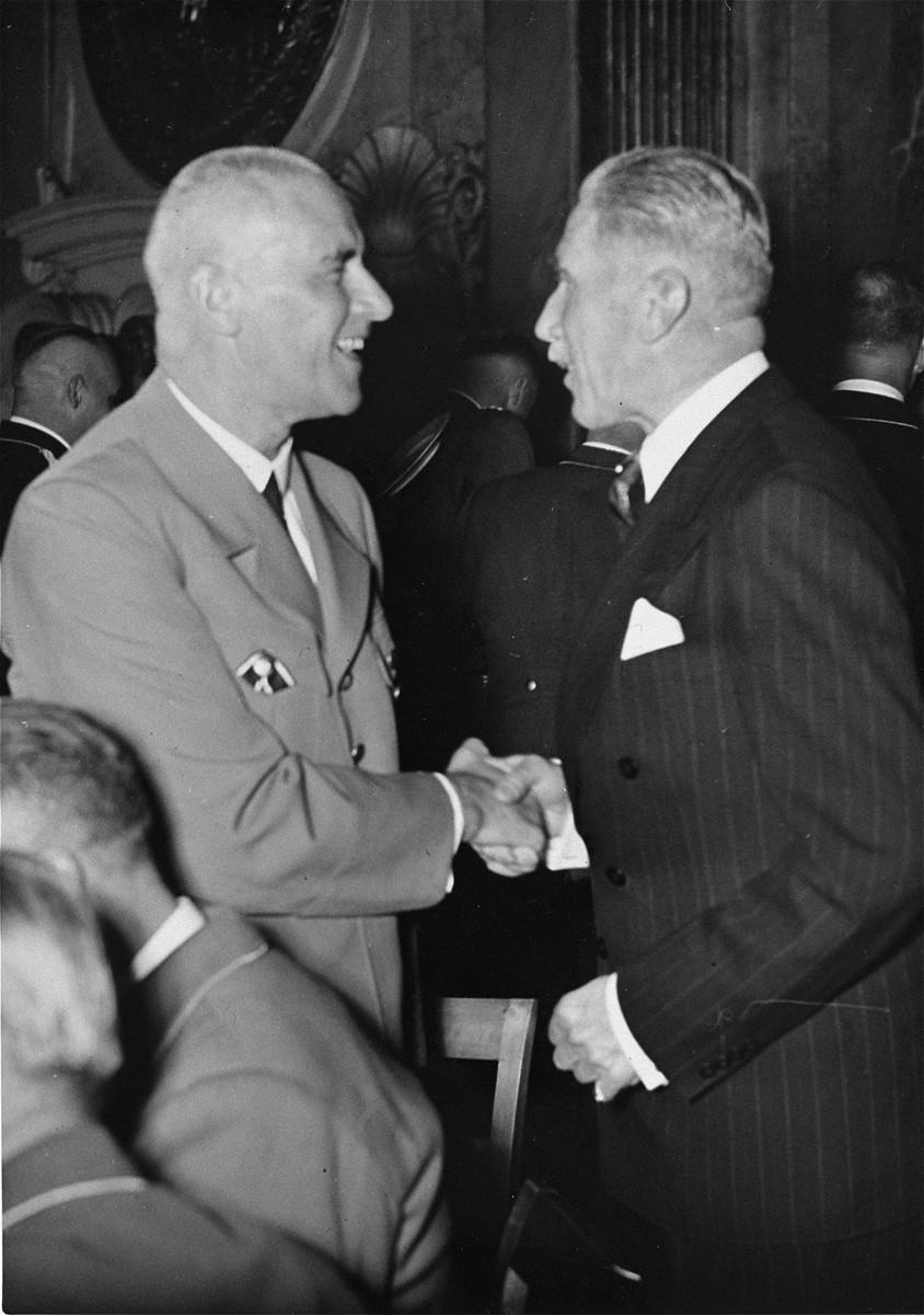 Wilhelm Frick (left) greets Franz von Papen at an unidentified reception.