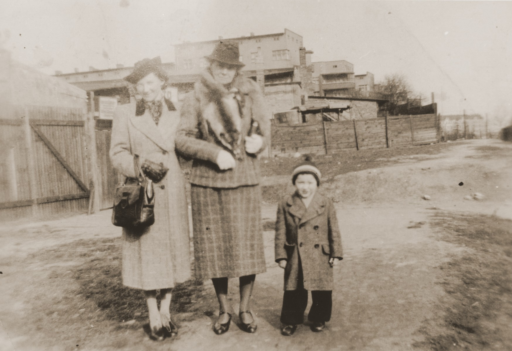 Mathilde Stern stands on an unpaved road in Willebadessen with her daughter-in-law, Resi Markhoff Stern, and grandson, Manfred.