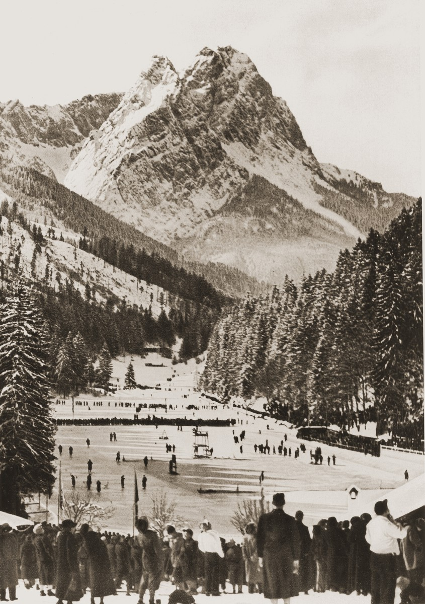 Spectators watch skaters on the Riessersee, near Garmisch-Partenkirchen, which was the site of many of the 1936 Winter Olympic events, including ice hockey and speed-skating.