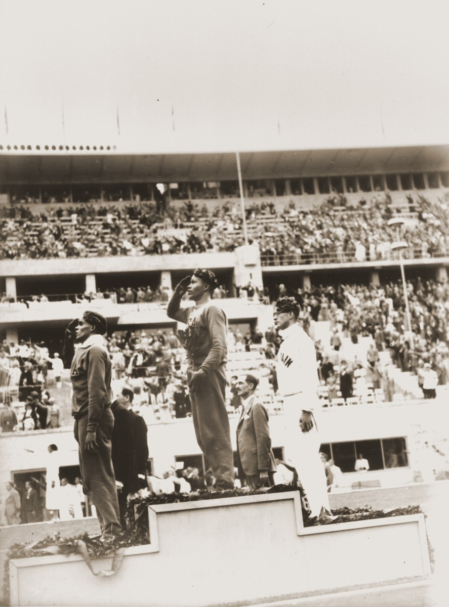 The medal winners of the men's 400m at the 11th Summer Olympic Games.   They are Archie Williams and James E. Lu Valle of the United States (Gold and Bronze), and Arthur Brown of Great Britain (Silver).