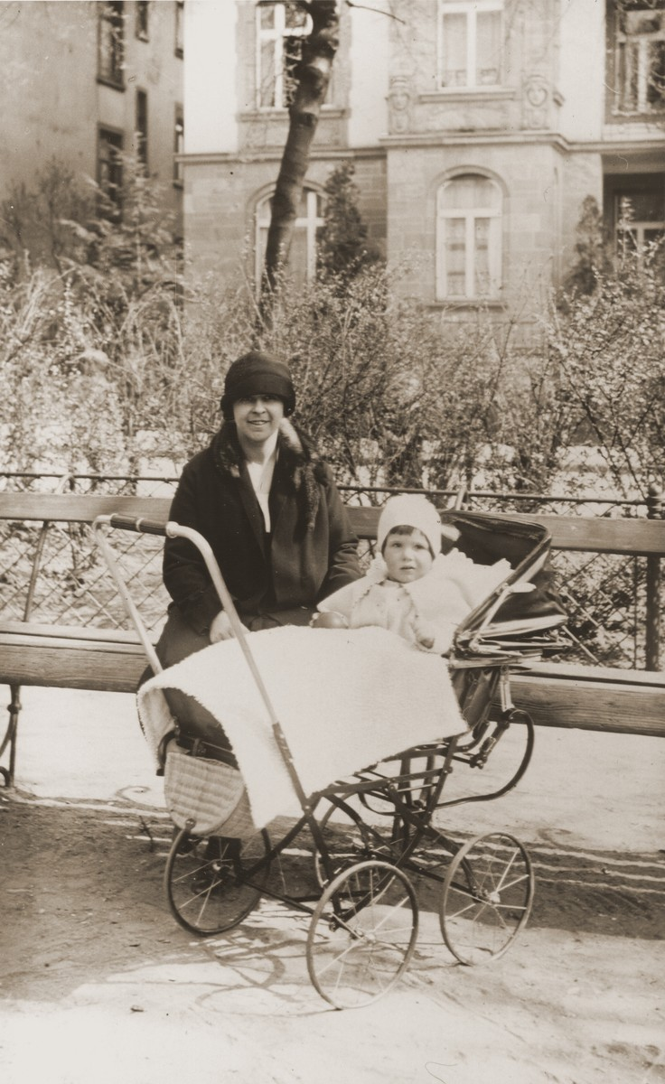 Gertrud Gotthelf poses with her daughter, Lore, who is sitting in a baby carriage.