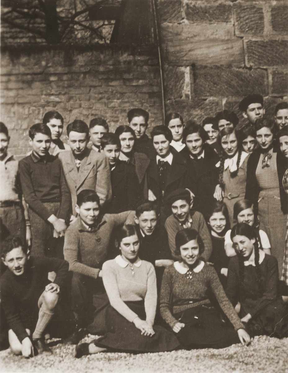 Group portrait of students at the Juedische Realschule [Jewish high school] in Fuerth.    Among those pictured is Henry [Heinz Alfred] Kissinger (front row, left).