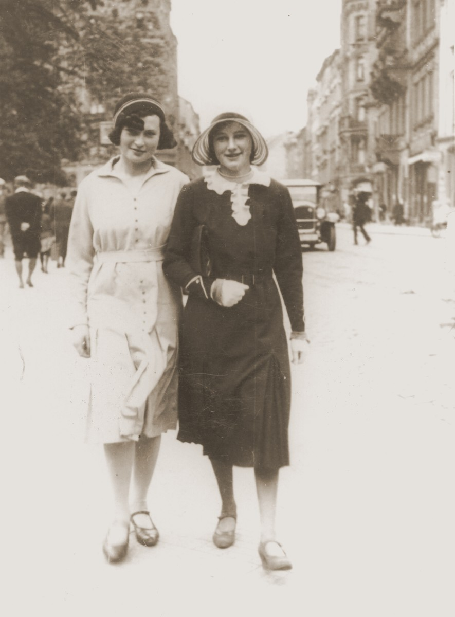 Resi Markhoff Stern walks down a Berlin city street with a friend.