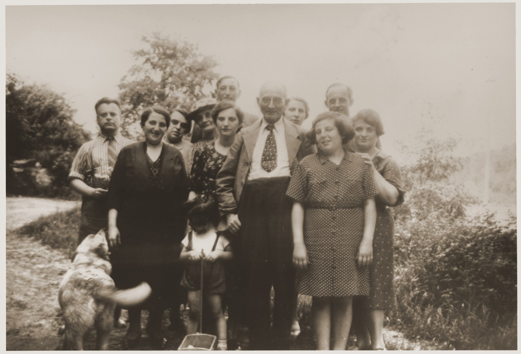 Group portrait of members of the Mendel and Vogel families in front of Sigmund Vogel's house in Nieder-Saulheim,Wollstein, Germany.    Among those pictured are Elsa Mayer Mendel (the donor's grandmother, front row, left), Sigmund Vogel (the donor's grandfather, front row, second from the right), Flora Vogel Mendel (the donor's mother, second row, right) Hannah Nachman Vogel (center, behind child) and Gertrude Mendel Kahn (front row; right).