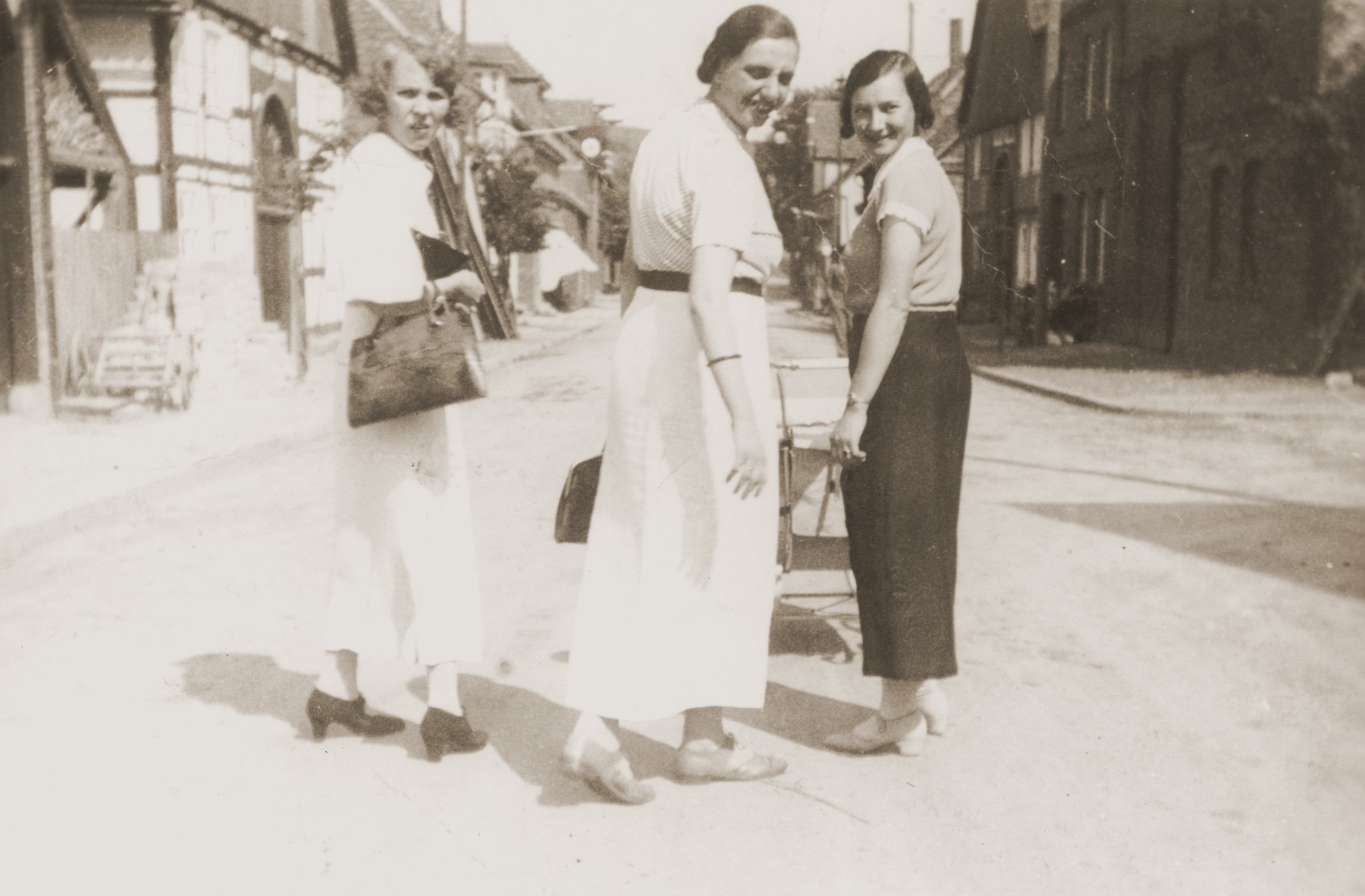 The three Stern sister-in-laws, Lizbet (left), Hedva (center) and Resi (right), walk down a street in Willebadessen.