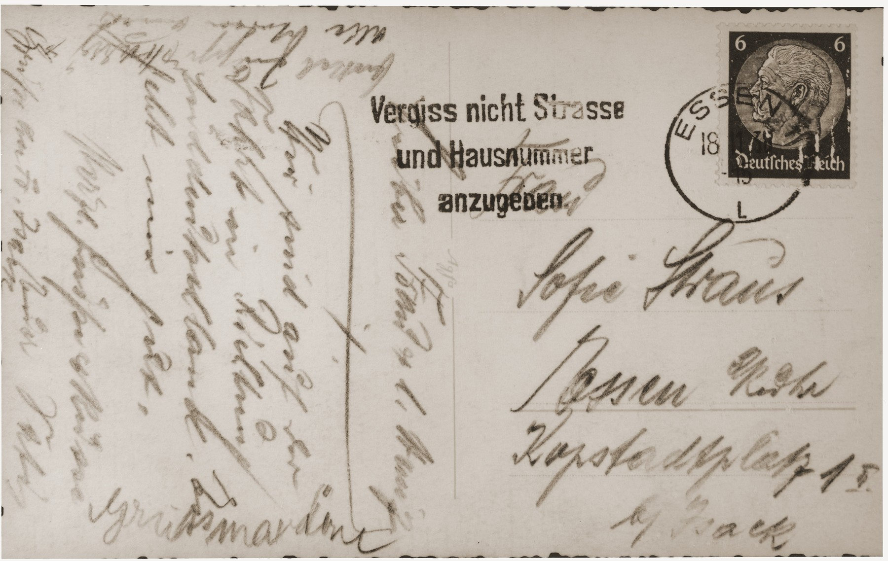 The verso of a postcard sent by Gustav Straus to his wife and son in Essen while he was en route to Dachau, following his arrest on Kristallnacht.    Gustav writes that they are traveling towards southern Germany and he is well.