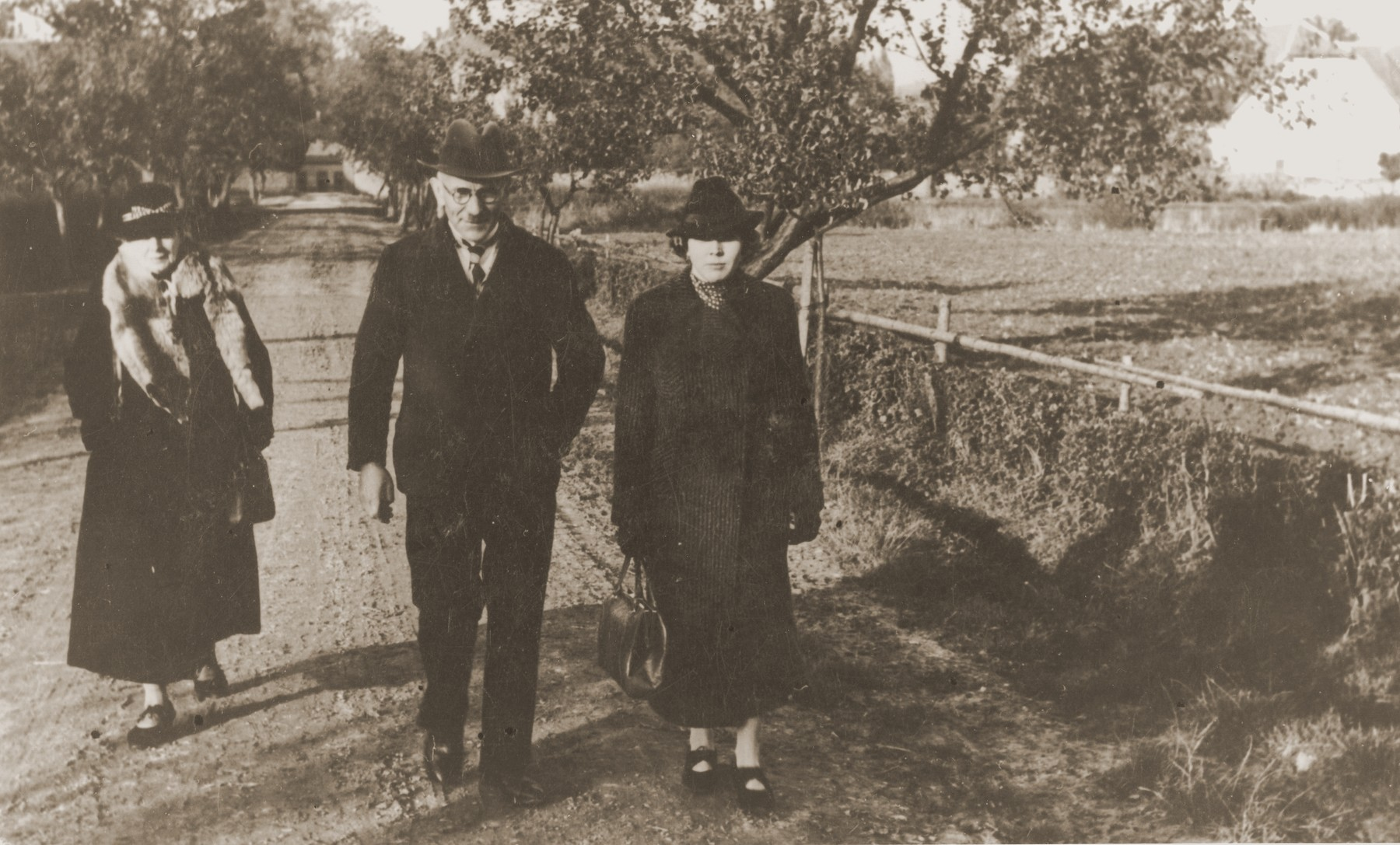 Julius and Mathilde Stern walk along a country lane with their daughter-in-law, Resi Markhoff Stern.