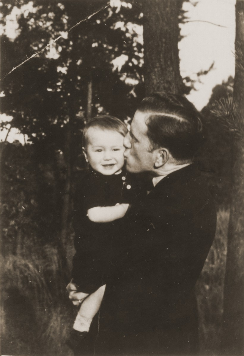 Viktor Stern holds and kisses his son, Manfred.