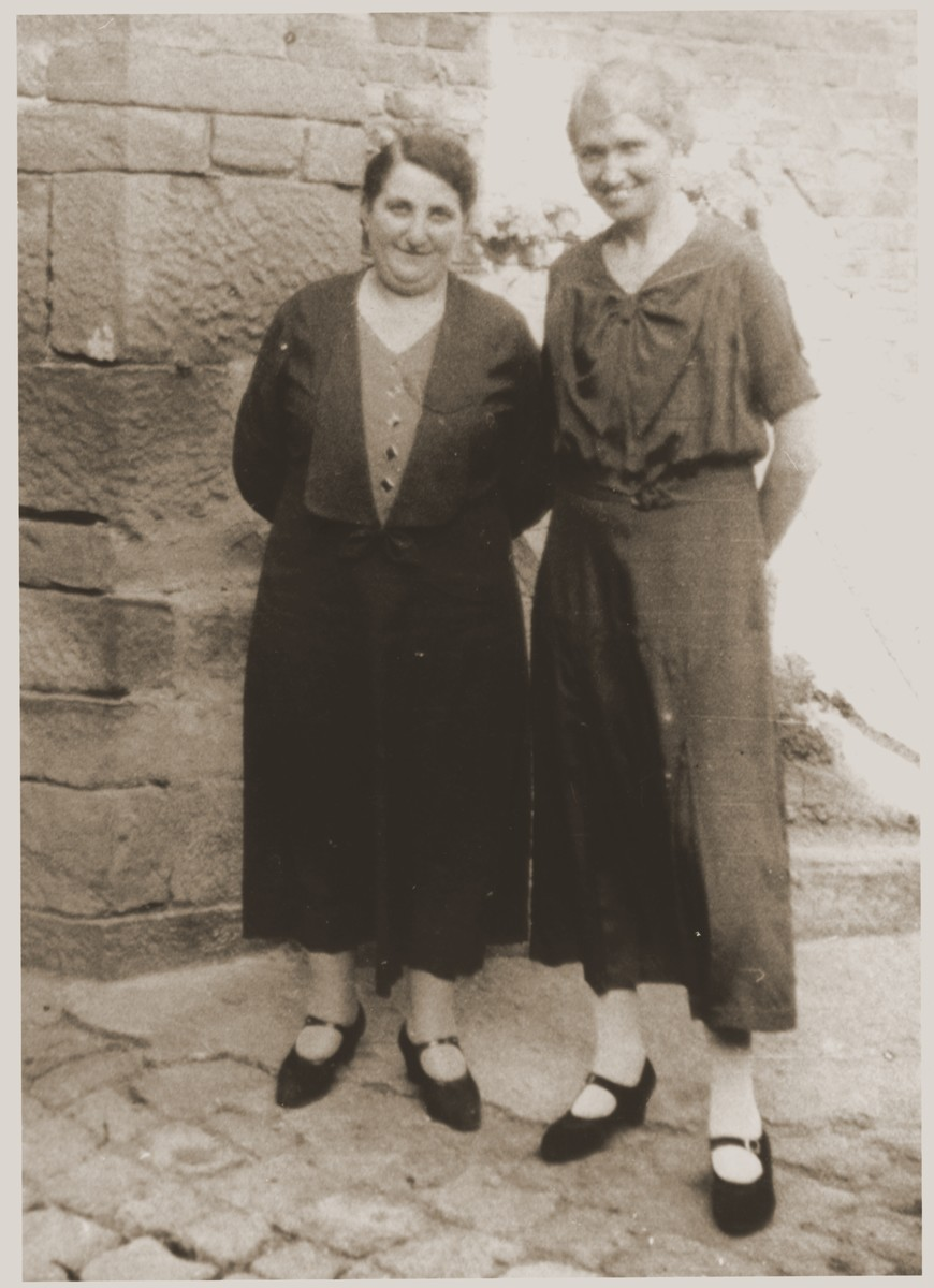 Two Jewish women pose outside in Wollstein, Germany.  Pictured are Elsa Mendel (right) and her friend, Lina Nachman (left).  Elsa Mendel is the aunt of donor Werner Mendel.  Lina survived several concentration camps and immigrated to the United States after the war.
