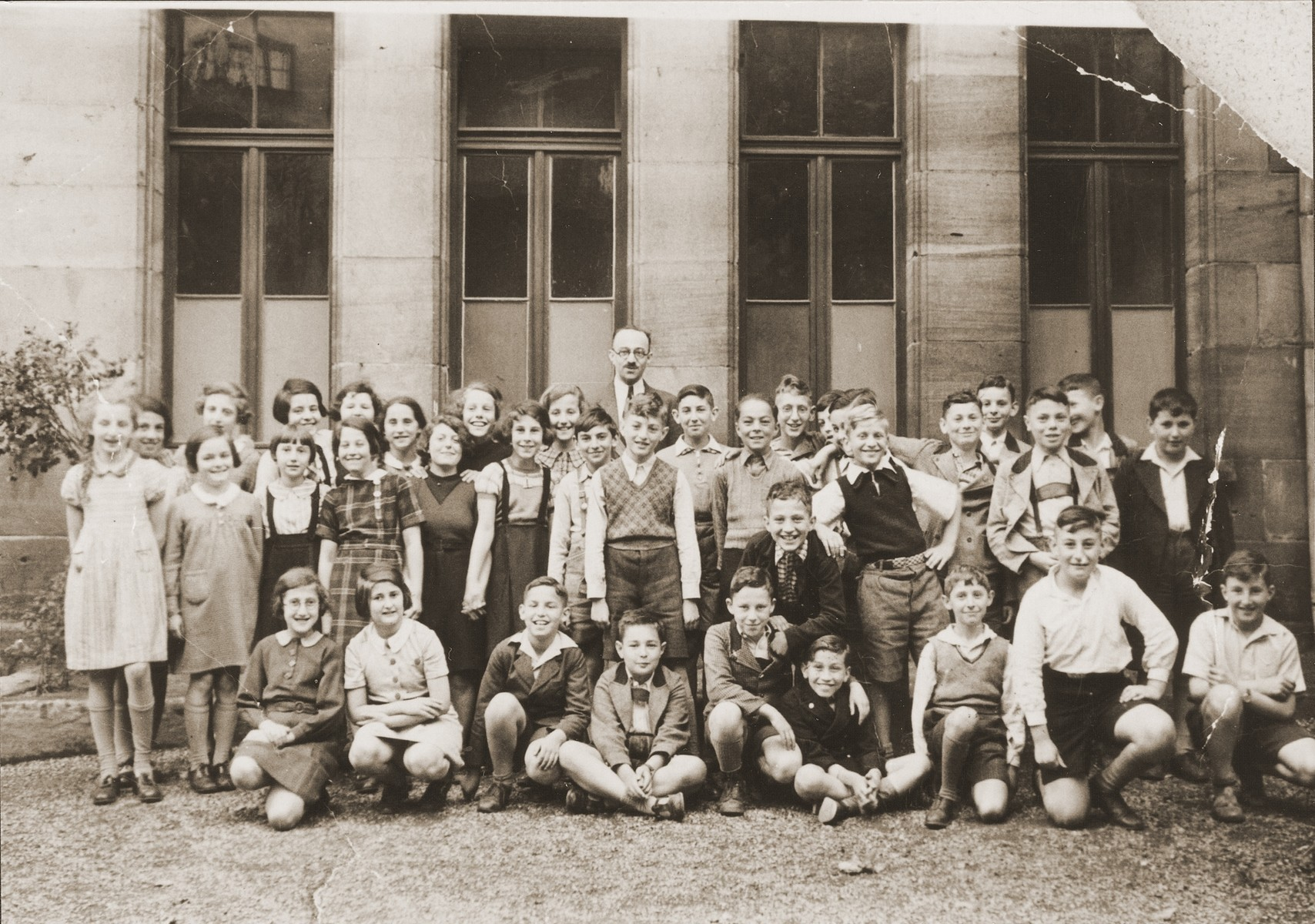 Group portrait of students at the Juedische Realschule in Fuerth with their teacher, Benno Heinemann.