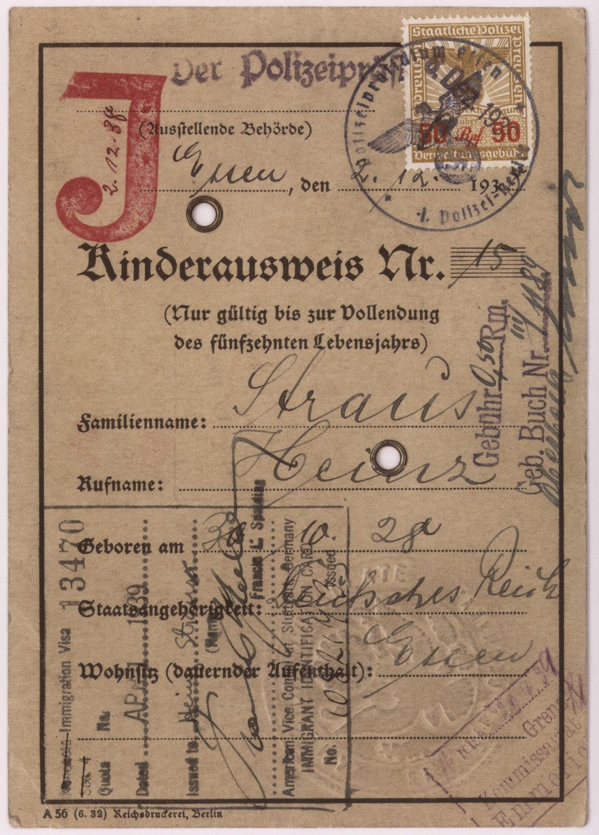 """The front of a children's identification card stamped with a """"J"""" for """"Jude,"""" issued to Heinz Straus on December 6, 1938, which allowed him to emigrate with his family to the United States."""