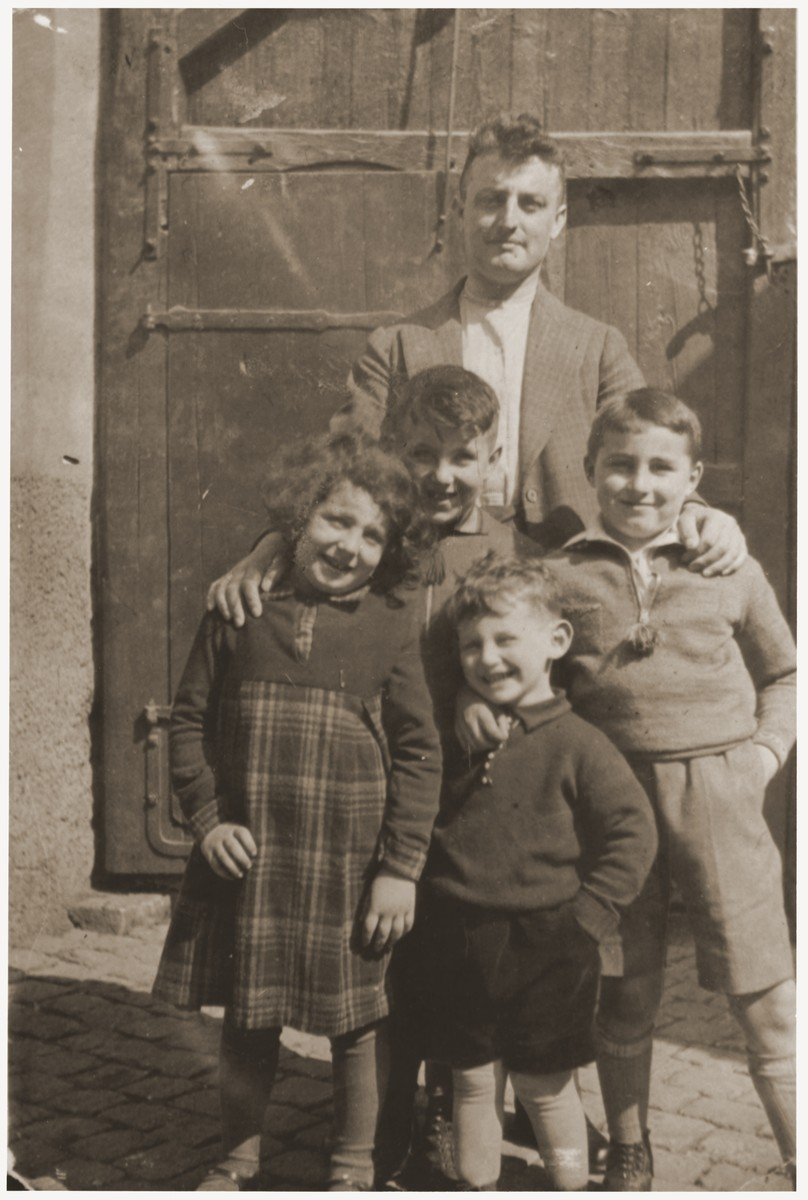 Albert Mendel poses with his son Ernst (center, front), his niece, Gertrude Mendel, and nephews, Walter Mayer and Paul Mendel.