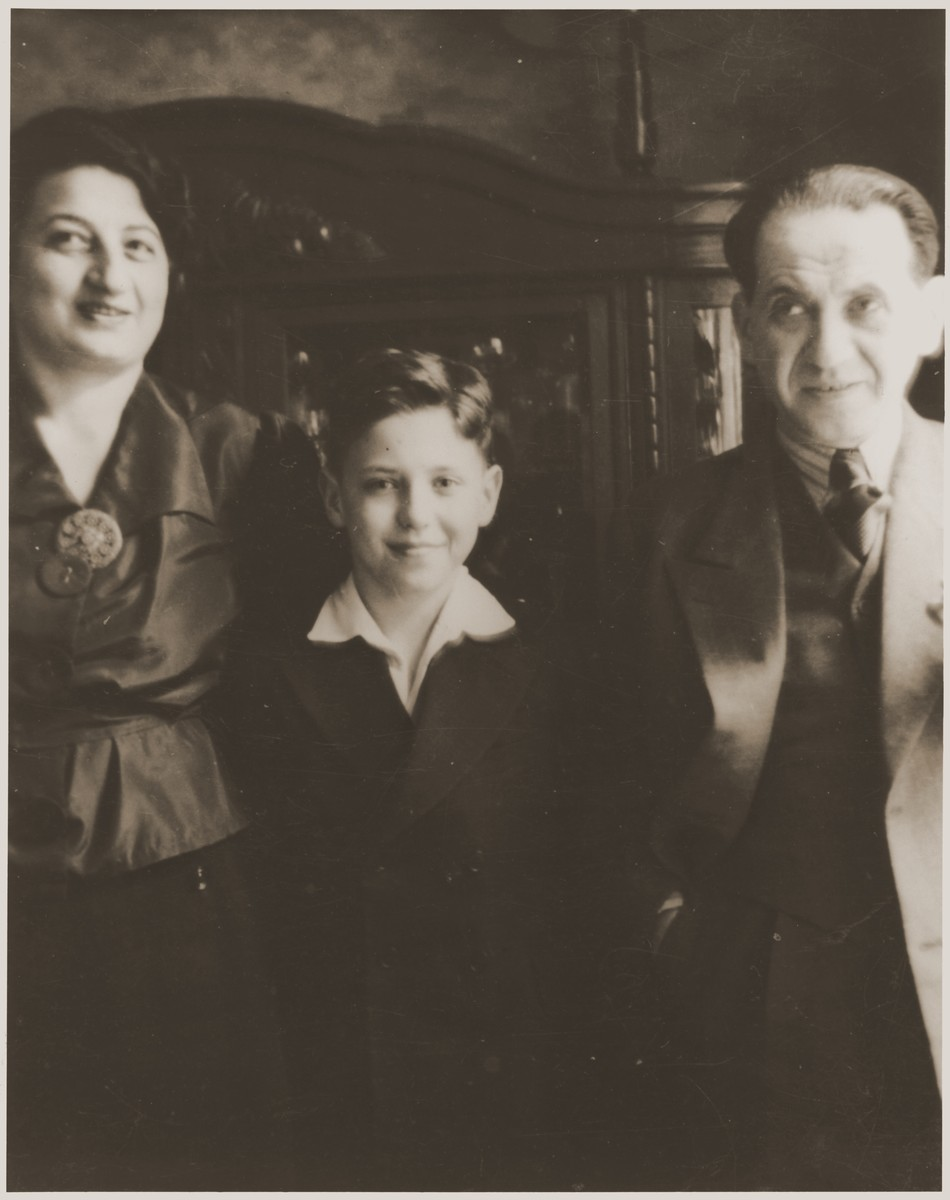 Heinz Stephan Lewy poses with his father and stepmother in their home in Berlin, shortly before his departure on a Kindertransport to France.