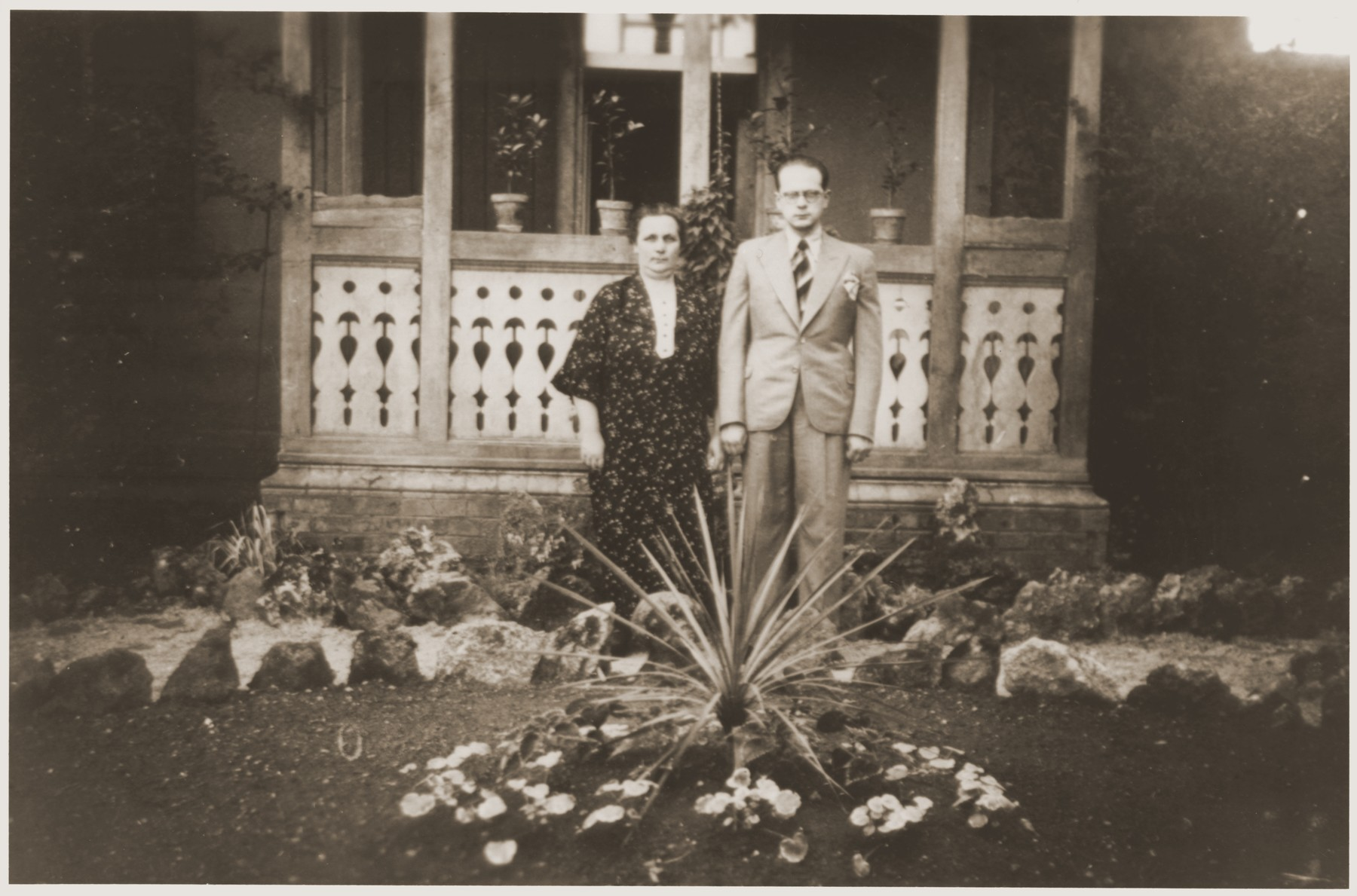 A Jewish mother and son pose in front of their home in Wollstein, Germany.  Pictured are Bertha Moster and her son, Bert.  Bertha was a distant cousin of the donor Werner Mendel.  The Mosters later emigrated to Argentina.