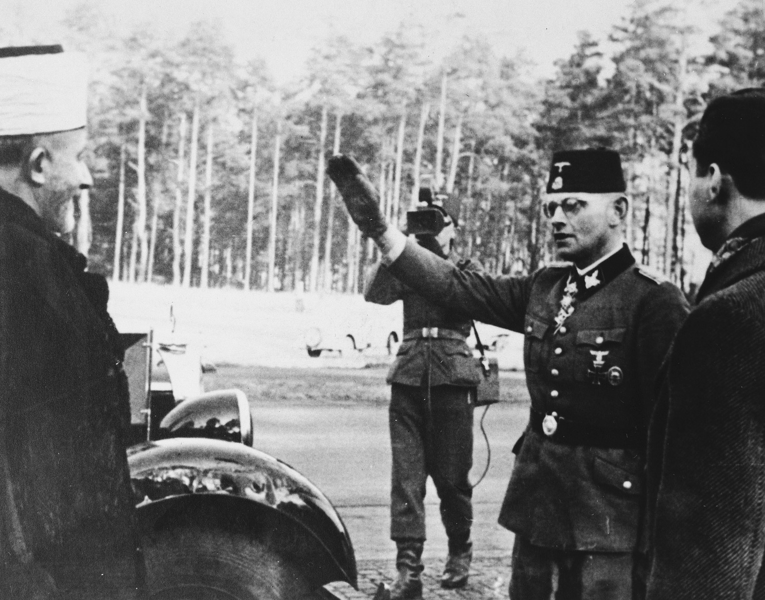 "Karl-Gustav Sauberzweig, the German Waffen SS officer who commanded the 13th SS Division (""Handschar""), salutes Hajj Amin al-Husayni during his visit to Bosnia."
