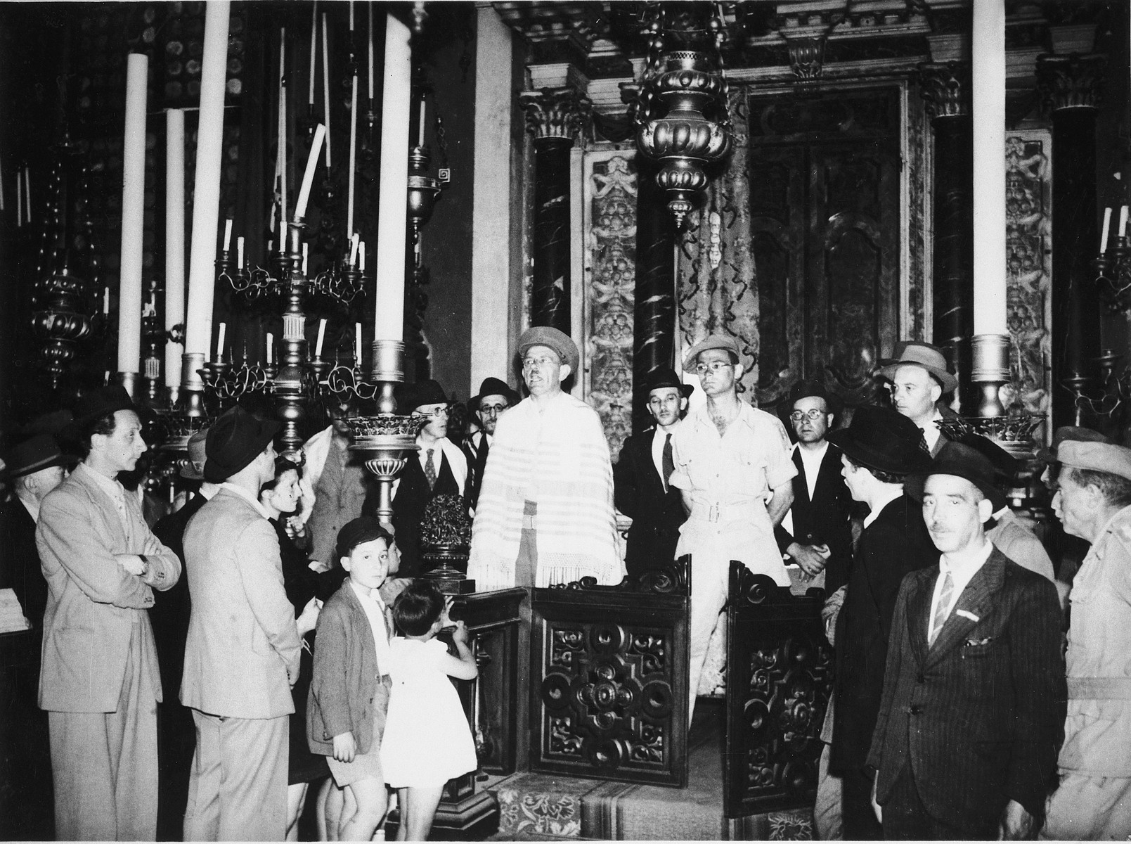 Jewish survivors gather in the Great German Synagogue in Venice.  Pictured to the left of the rabbi is Immanuel Ascarelli wearing his Jewish Brigade uniform.