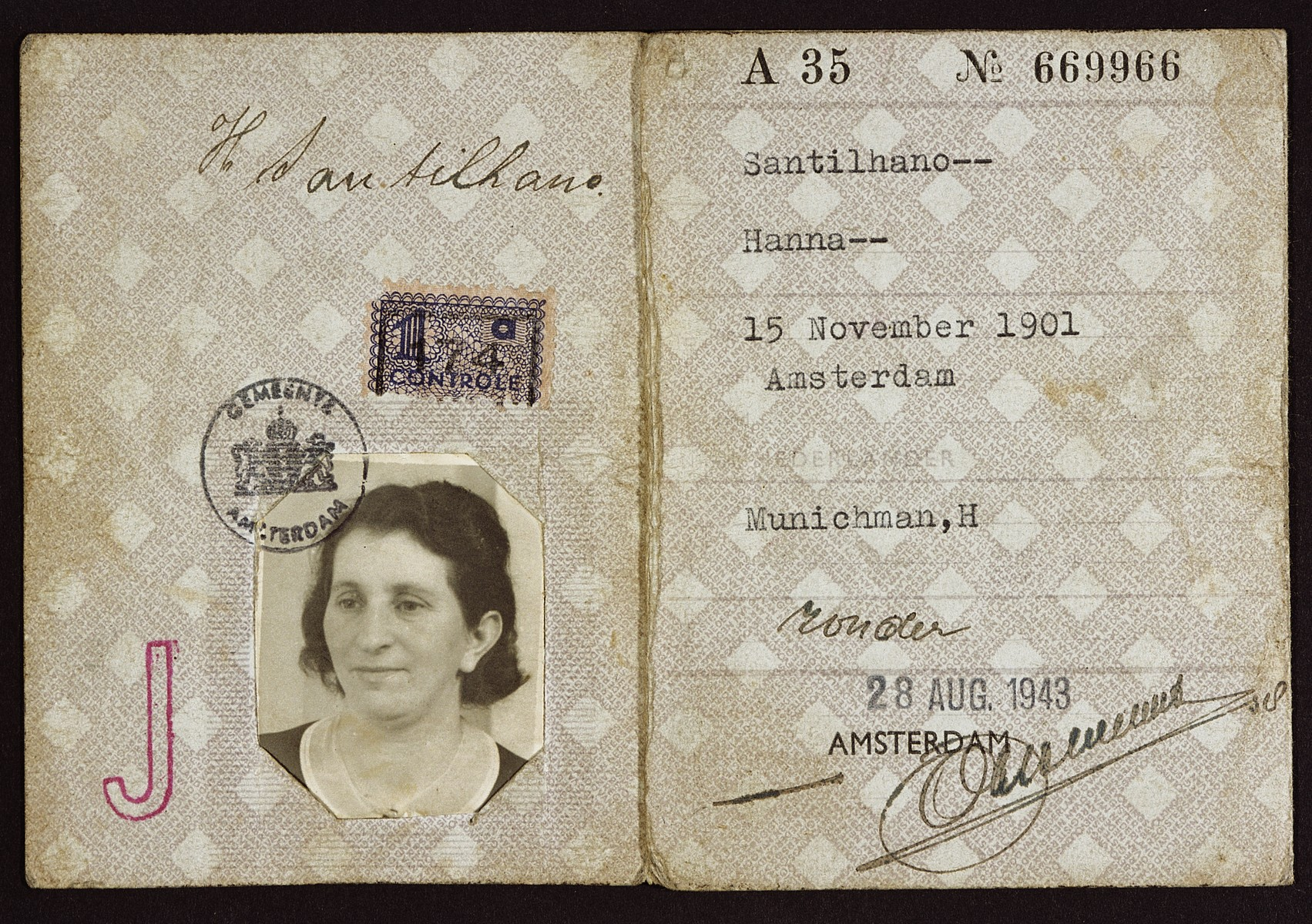 "Identity card issued to Hanna Santilhano Munichman with her photograph attached and stamped with red ""J""."