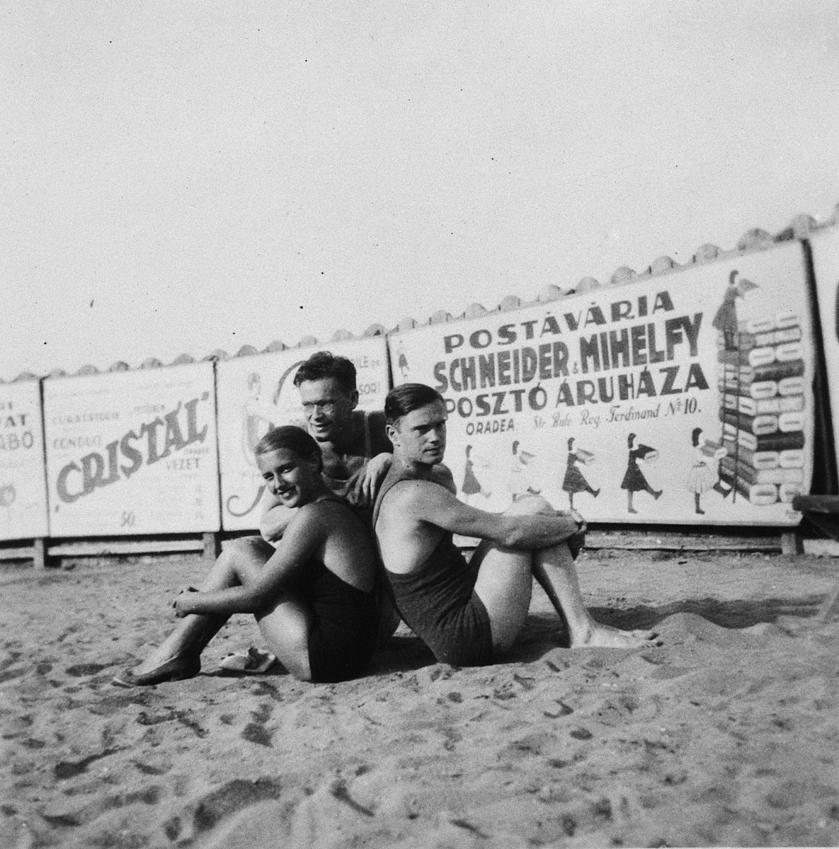 Three young people go swimming at the municipal swimming pool in Oradea.  Pictured are Ladislaus Farkas (center) and his brother, Adalbert (right).  Eva Fuks is on the left.