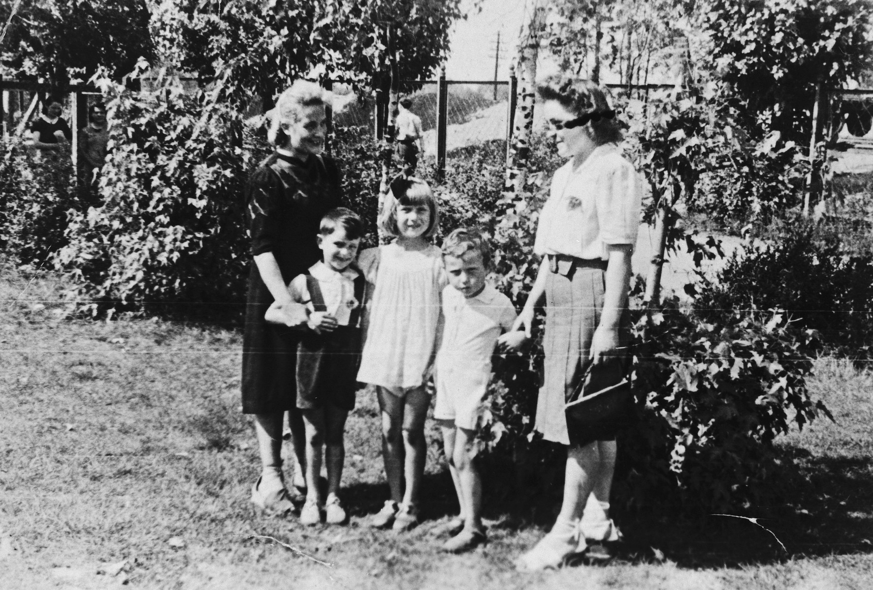 Szaje and Sura Grynberg pose with another family in Stawki where they were hiding under assumed identities.