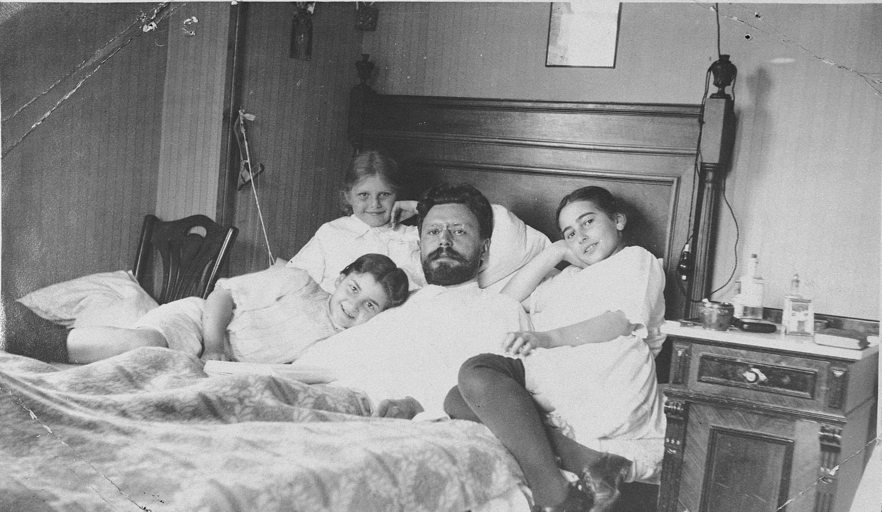 Sophie Libo's grandfather lies in bed surrounded by his daughter, Nina, and two nieces.