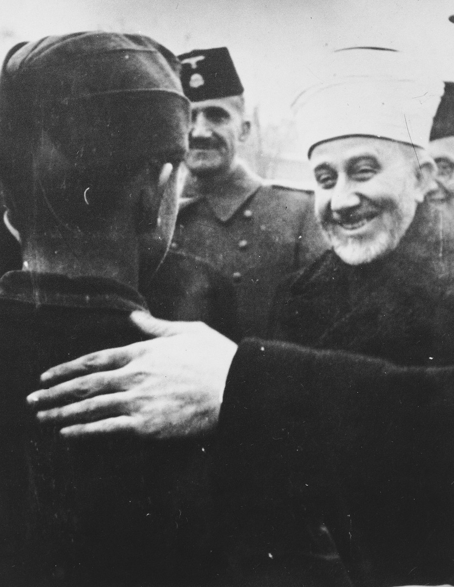 Hajj Amin al-Husayni greets a Bosnian member of the Waffen-SS during his visit to Bosnia.