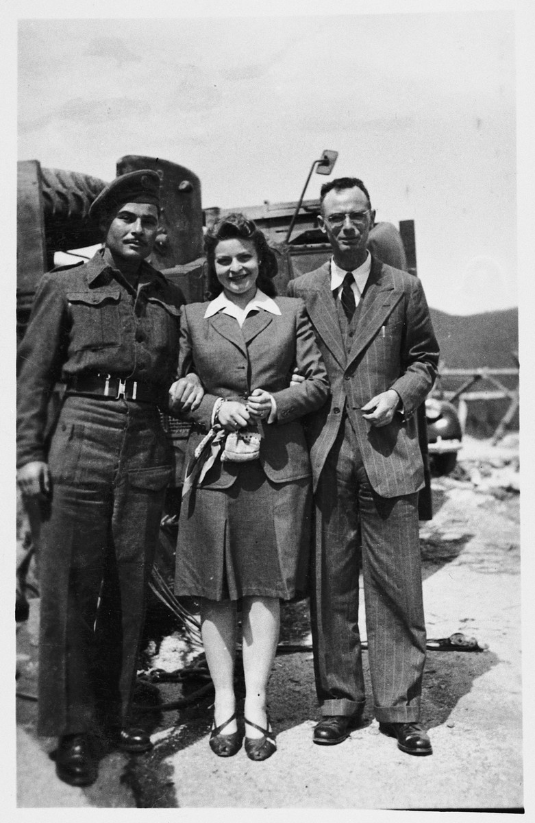 Roma and Immanuel Ascarelli pose next to a military vehicle along with another friend from the Jewish Brigade.