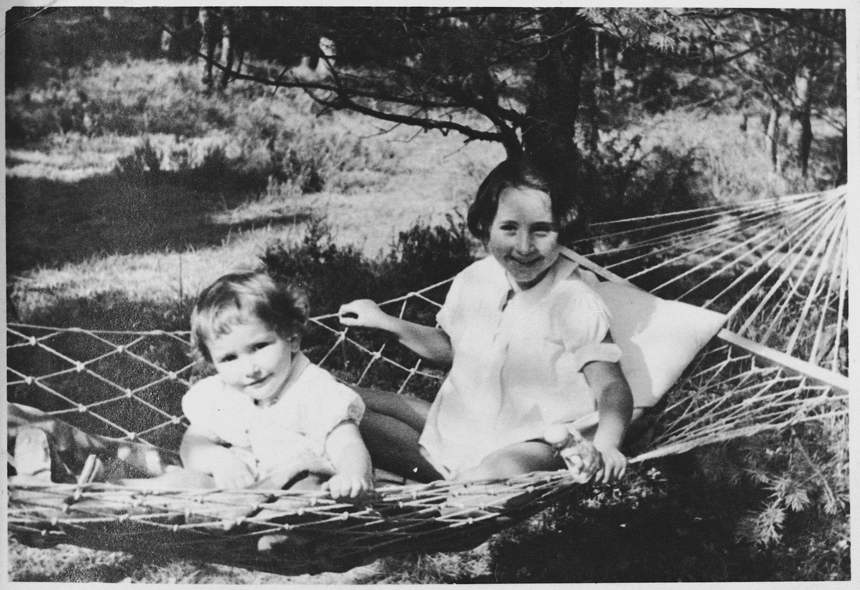 Two young sisters share a hammock.  Pictured are Sophie and Luba Libo.
