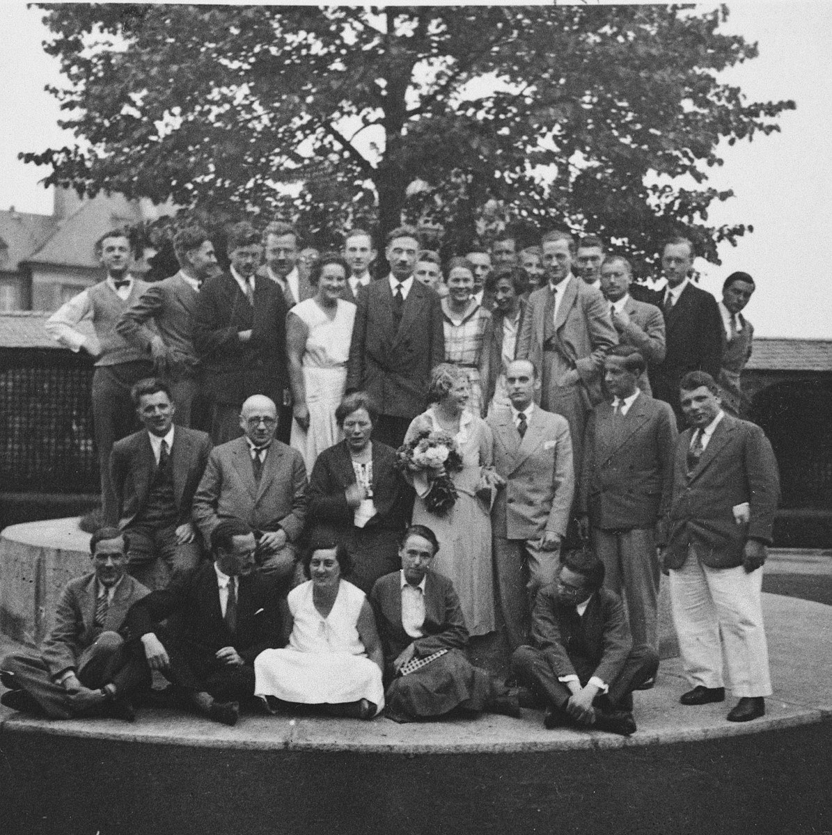 Staff of the Kaiser Wilhelm Institute celebrate the wedding of two of its members.  The bride (standing, second row) is Gretl Magnus who was librarian and secretary of Prof. Herbert Freundlich.  The groom is Dr. Zander, a jurist.  They immigrated to England.  Most of the staff members of the Kaiser Wilhelm Institute were Jewish.
