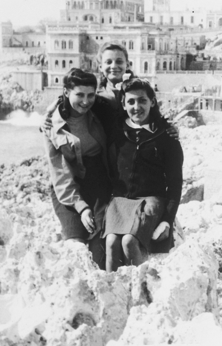 Portrait of three teenage girls in the Santa Cesarea displaced persons' camp.  Rachel Mutterperl is on the left.