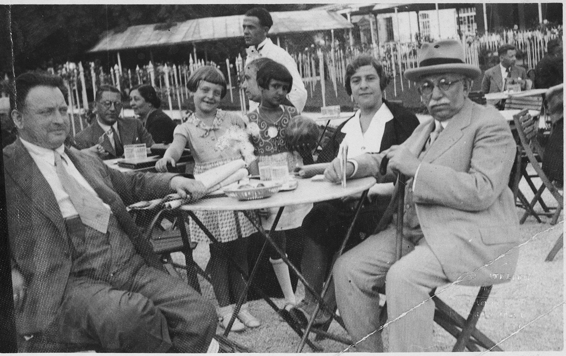 The Wessel family enjoys a visit to an outdoor cafe.  Pictured from left to right are Samuel Wessel, his daughter Roma, a friend, his wife Rosa and another friend or relative.