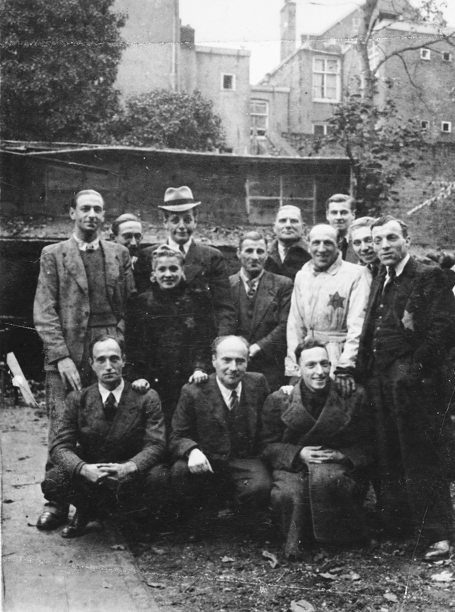 Group portrait of Dutch Jews taken in the courtyard of the Joodsche Schouwburg theater the day before their deportation.  Among those pictured is Sally Santilhano (uncle of the donor) in the center, wearing a white jacket.