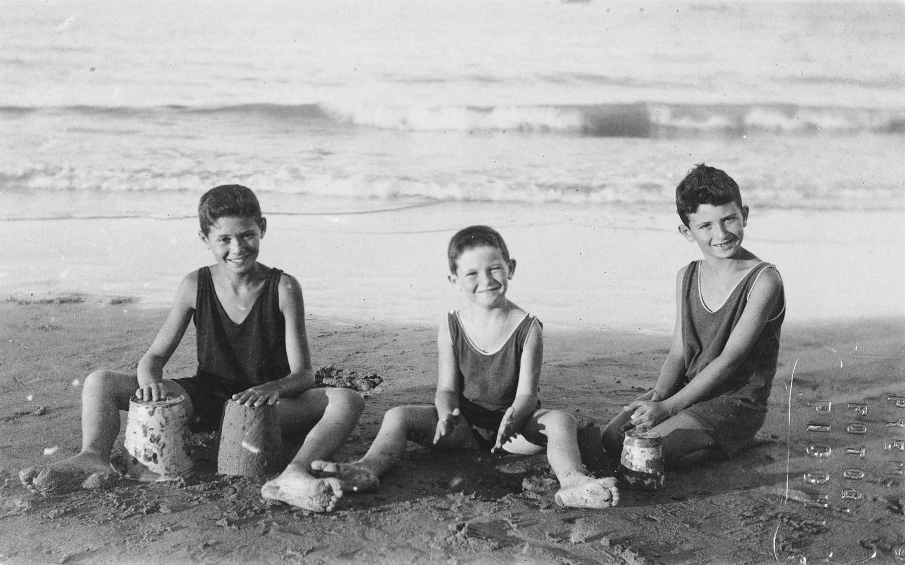 Three brothers build sandcastles at a beach near Bologna.  Pictured are Mancio, Immanuel and Aldo Ascarelli.