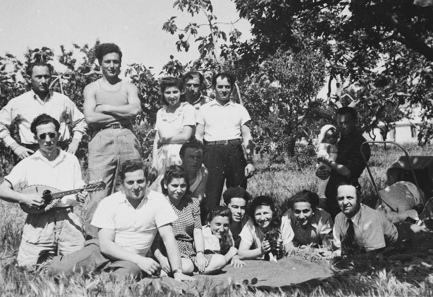 Jewish youth pose for a group portrait during an outdoor social gathering in the Bari displaced persons' camp.