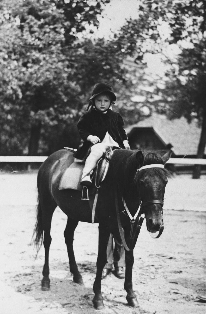 Jeanna Nachmias rides a pony through a park in Belgrade.