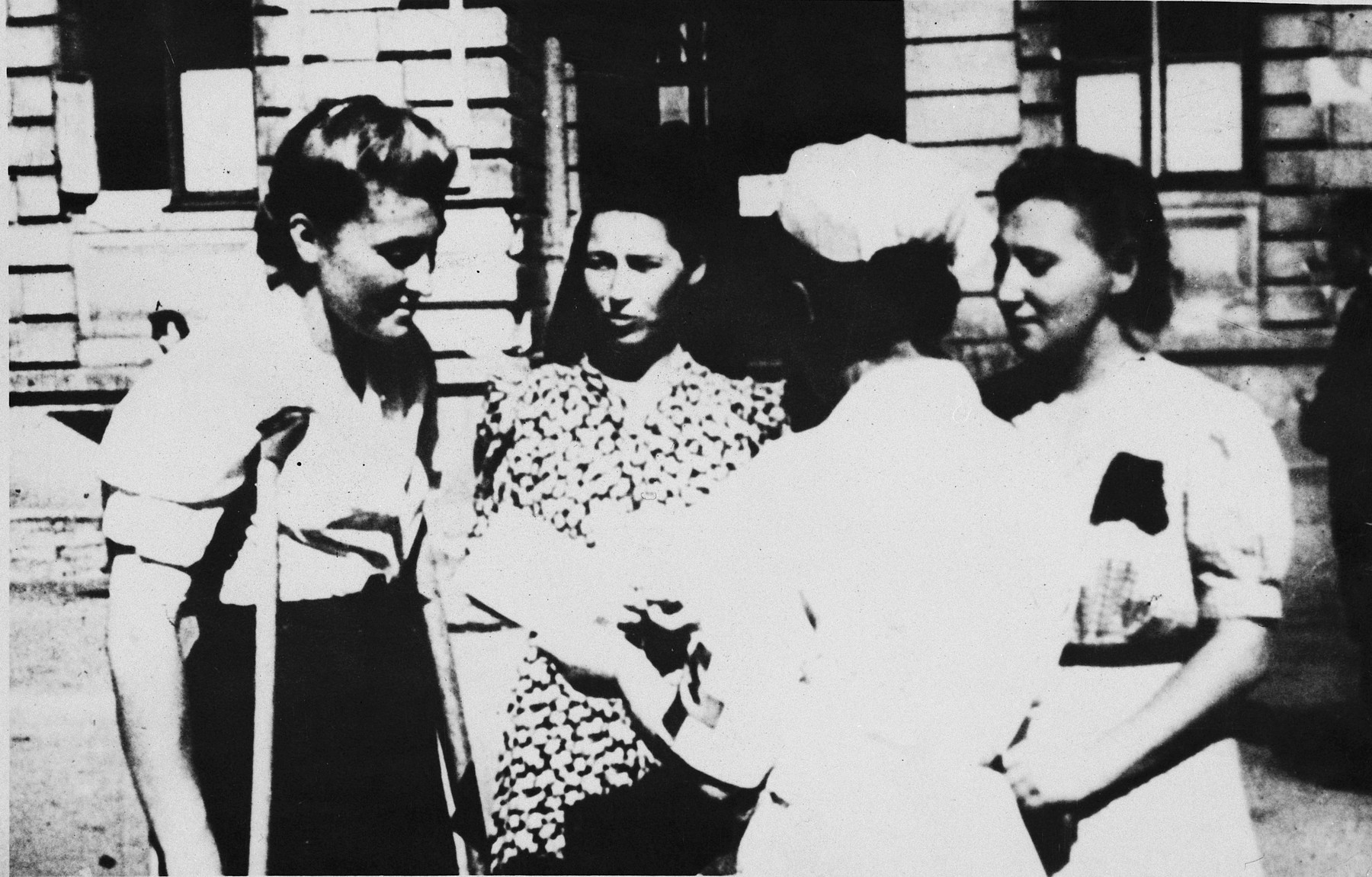 A nurse converses with three Polish female survivors of the Ravensbrueck concentration camp who had been subjected to medical experimentation during their imprisonment.  Pictured from left to right are: Maria Kusmierczuk, Wladislawa Karolewska and Jadwiga Dzido.